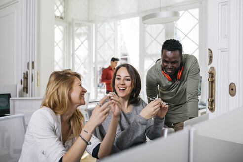 Business people working together in international office - JRFF01343