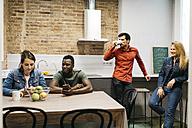 Colleagues having a break in office kitchen - JRFF01385