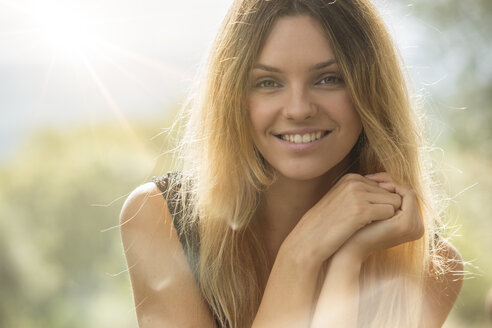 Portrait of smiling blond woman - ZOCF00445