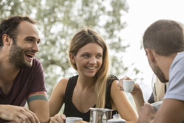 Four friends having fun at breakfast table - ZOCF00454