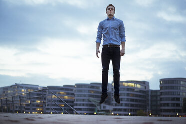 Portrait of young man jumping in the air - JOSF01044