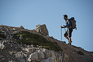 Italy, Man trekking in the Dolomtes - ZOCF00464