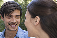 Young man smiling at girlfriend - WESTF23182