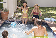 Group of friends having fun in swimming pool - WESTF23212