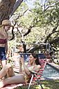 Two young women with cell phone at the poolside - WESTF23230