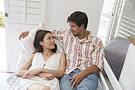 Young couple lying in bed - WESTF23254