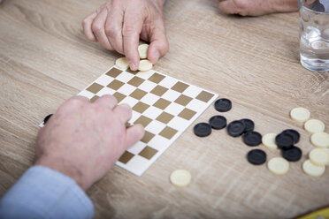 Two people playing chequers - WESTF23368