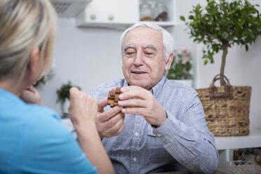 Gereatric nurse doing dexterity games with elderly patient - WESTF23374
