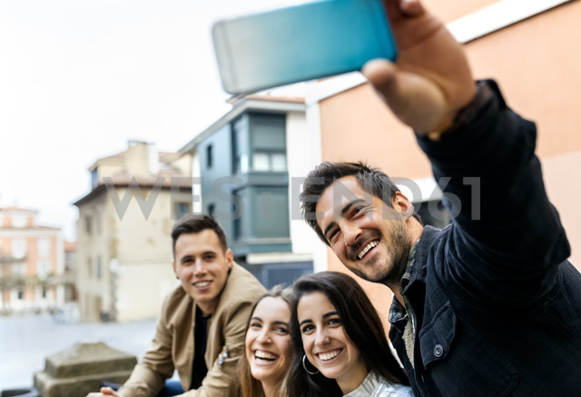 Group of friends taking a selfie in the city - MGOF03401