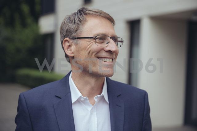 Portrait of smiling mature businessman outdoors - MFF03608