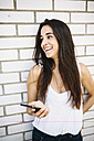 Young woman holding smartphone - GIOF02734