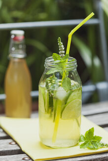 Glass of ice-cooled homemade cucumber lime lemonade with mint leaves - GWF05234