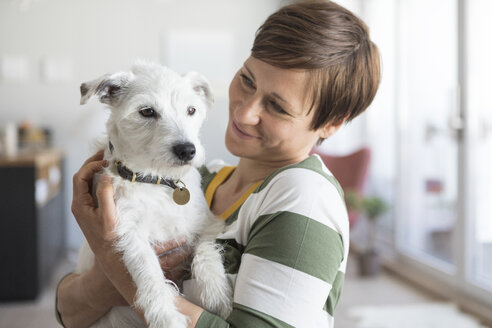 Woman wth her dog at home - RBF05703