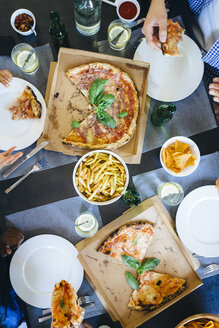 Friends having pizza and French fries - GIOF02749