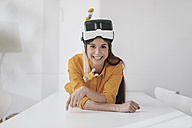 Young woman with VR glasses and snorkel planning next vacation - JOSF01083