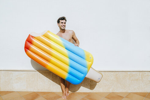 Man with ice cream float in front of white wall - KIJF01527