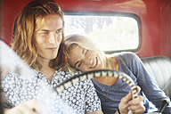 Smiling young couple in an old pick up - ZEF13879