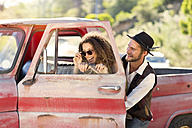 Happy young couple at old pick up truck - ZEF13888