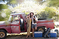 Young couple at old pick up truck - ZEF13891