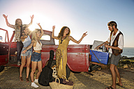 Happy young people outside pick up truck at the coast - ZEF13912