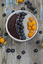 Bowl of joghurt with blueberry mush, coconut flakes, physalis and blueberries - ODF01525