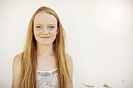 Portrait of smiling girl with long red hair - ZEF13923