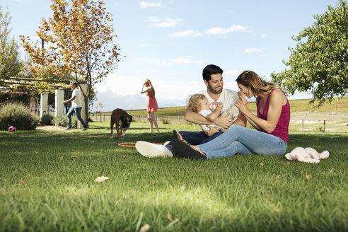 Happy family in garden - ZEF13941