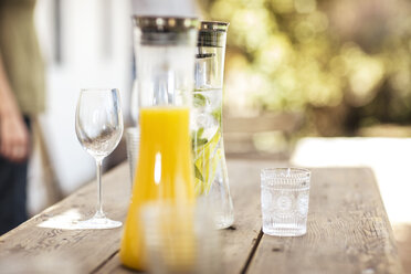 Carafe with refreshing drink outdoors on table - ZEF13956