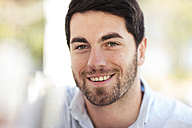 Portrait of smiling young man outdoors - ZEF13959