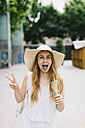 Woman with discolored tongue holding ice cream cone - JPF00217