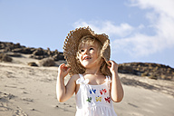 Spain, Fuerteventura, happy girl on the beach - MFRF00865