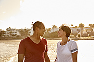 Spain, Canary Islands, Gran Canaria, couple in love face to face on the beach - PACF00003