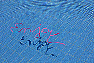 Word enjoy in water of a swimming pool - PSTF00041
