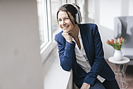 Portrait of woman listening music with headphones - JOSF01179