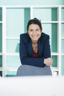 Portrait of smiling businesswoman in office - JOSF01203