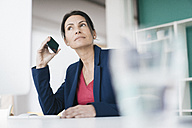Portrait of smiling businesswoman on the phone - JOSF01206