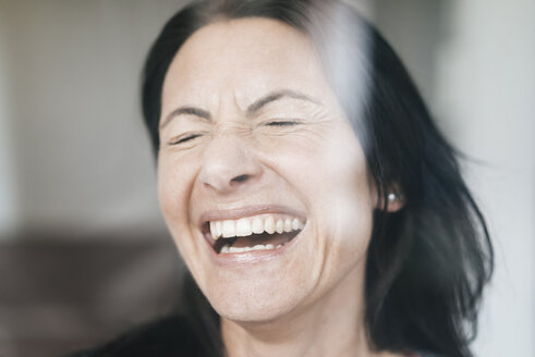 Portrait of laughing woman with eyes closed - JOSF01230