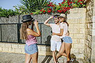 Woman taking a picture of a couple - KIJF01596