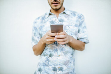 Close-up of man holding cell phone - KIJF01623