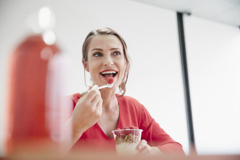 Woman having healthy lunch break in office - RHF01977