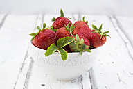 Bowl of strawberries on white wood - LVF06167