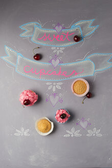 Cup cakes with cherry topping on painted blackboard - MYF01931