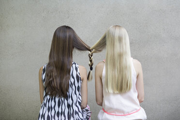 Back view of two long-haired girls with one braid - PSTF00053