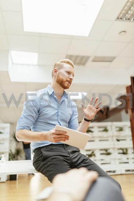 Businessman holding tablet during presentation - ZEDF00613