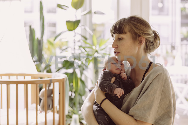 Mother soothing and comforting her newborn baby boy at home - MFF03666