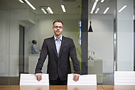 Manager standing in office boardroom - ZEF13993