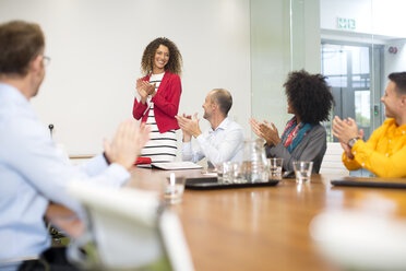 Business people applauding during a meeting in boardroom - ZEF13999