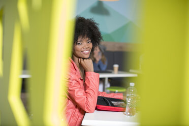 Portrait of smiling woman in office lounge - ZEF14020
