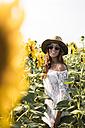 Happy woman in a sunflower field - MAUF01074