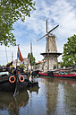 Netherlands, Gouda, harbor with traditional sailing ships and wind mill - EL01850